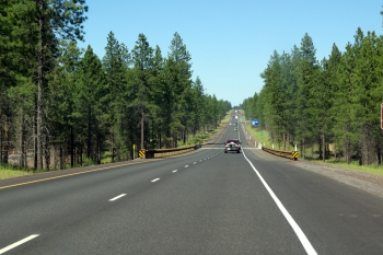 This project involved the construction of two new lanes of highway, which are separated from the original two lanes by a forested median.